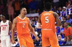 Tennessee forward Grant Williams (2) and guard Jordan Bone (0) celebrate after guard Admiral Schofield (5) made a 3-point shot against Florida in the final minute of an NCAA college basketball game Saturday, Jan. 12, 2019, in Gainesville, Fla. (AP Photo/Matt Stamey)