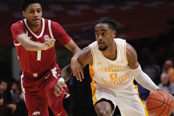 Tennessee guard Jordan Bone (0) brings the ball down the court against Arkansas guard Isaiah Joe (1) in the second half of an NCAA college basketball game, Tuesday, Jan. 15, 2019, in Knoxville, Tenn. (AP Photo/Shawn Millsaps)