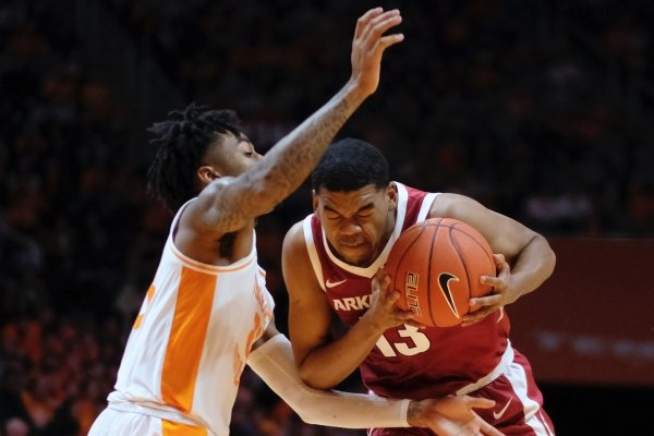 Arkansas guard Mason Jones (13) tries to drive the ball past Tennessee guard Jordan Bone (23) in the second half of an NCAA college basketball game, Tuesday, Jan. 15, 2019, in Knoxville, Tenn. (AP Photo/Shawn Millsaps)