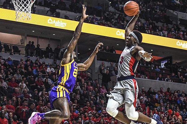 Mississippi guard Terence Davis (3) misses on a dunk attempt as LSU forward Emmitt Williams (24) defends during an NCAA college basketball game Tuesday, Jan,. 15, 2019, in Oxford, Miss. LSU won 83-69. (Bruce Newman/The Oxford Eagle via AP)