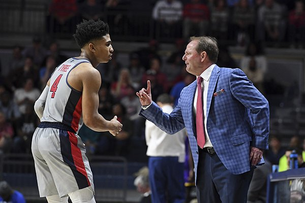 Ole Miss head coach Kermit Davis talks to guard Breein Tyree (4) during the first half of an NCAA college basketball game against LSU in Oxford, Miss., Tuesday, Jan. 15, 2019. (AP Photo/Thomas Graning)