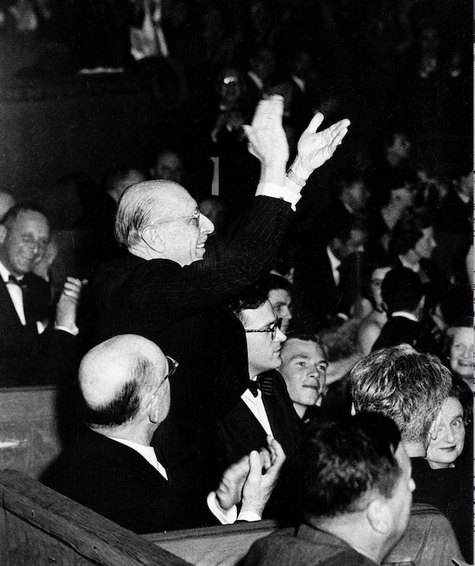 "Composer Igor Stravinsky applauds at the close of a performance of his ""Rite of Spring"" by the Boston Symphony Orchestra in Paris in this May 1952 photo. (Democrat-Gazette file photo)"