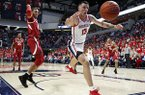 Mississippi center Dominik Olejniczak (13) chases a loose ball during the first half of the NCAA college basketball game against Arkansas in Oxford, Miss., Saturday, Jan. 19, 2019. (AP Photo/Rogelio V. Solis)