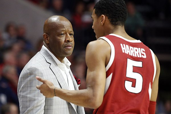 Arkansas head coach Mike Anderson confers with guard Jalen Harris (5) during the second half of the NCAA college basketball game against Mississippi, in Oxford, Miss., Saturday, Jan. 19, 2019. Mississippi won 84-67. (AP Photo/Rogelio V. Solis)