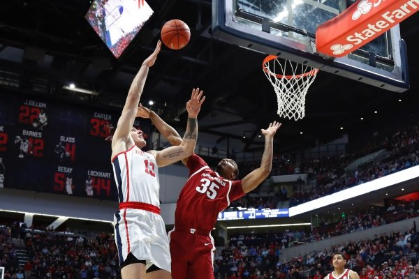 Mississippi center Dominik Olejniczak (13) shoots a hook shot over Arkansas forward Reggie Chaney (35) during the first half of the NCAA college basketball game in Oxford, Miss., Saturday, Jan. 19, 2019. (AP Photo/Rogelio V. Solis)