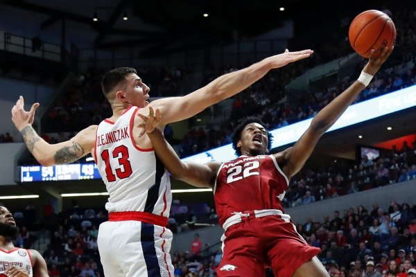 Arkansas forward Gabe Osabuohien (22) shoots past Mississippi center Dominik Olejniczak (13) during the second half of the NCAA college basketball game in Oxford, Miss., Saturday, Jan. 19, 2019. Mississippi won 84-67. (AP Photo/Rogelio V. Solis)