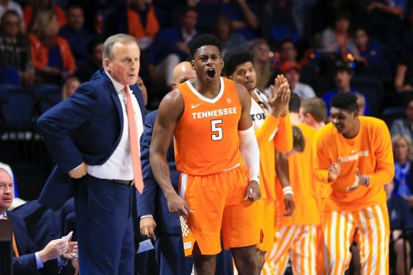 Tennessee guard Admiral Schofield (5) celebrates next to coach Rick Barnes during the second half of the team's NCAA college basketball game against Florida on Saturday, Jan. 12, 2019, in Gainesville, Fla. (AP Photo/Matt Stamey)