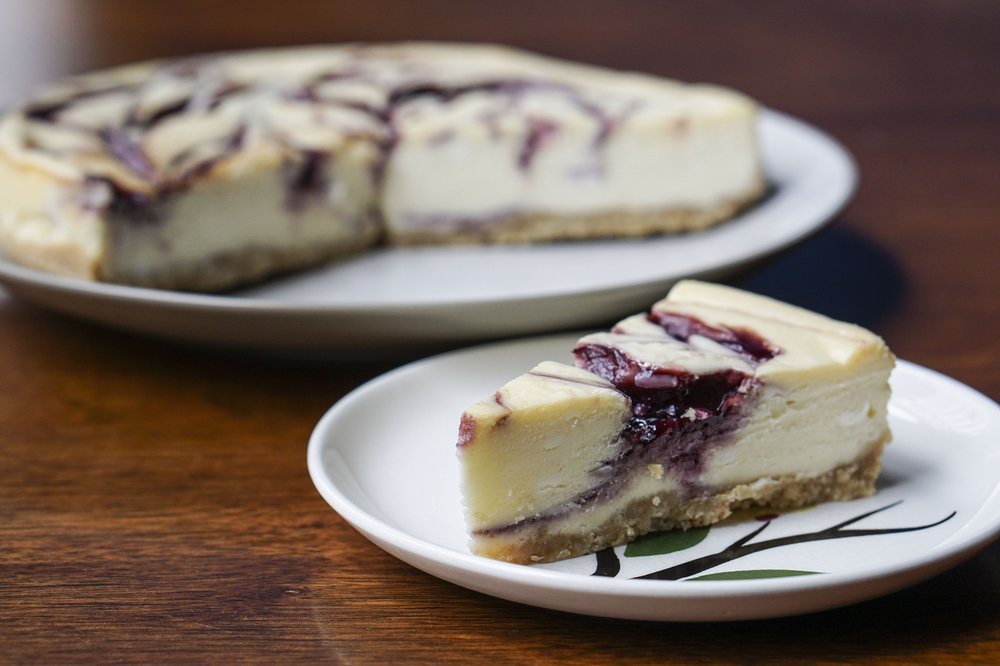 White Chocolate-Blackberry Cheesecake is made using our basic cheesecake formula flavored with four ounces of melted white chocolate and a swirl of blackberry jam. Photo by Mitchell Pe Masilun