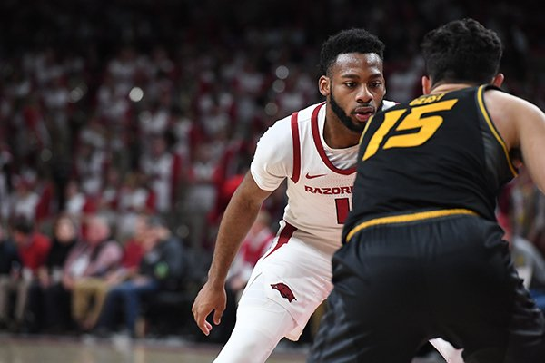 Arkansas guard Keyshawn Embery-Simpson guards Missouri guard Jordan Geist during a game Wednesday, Jan. 23, 2019, in Fayetteville.