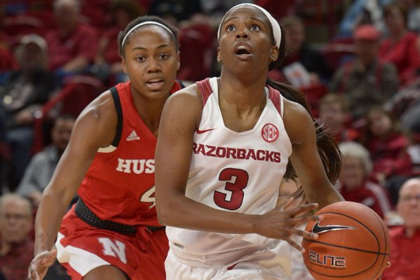 Arkansas guard Malica Monk (3) drives past Nebraska guard Sam Haiby Tuesday, Dec. 18, 2018, during the first half of play in Bud Walton Arena.