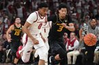 Arkansas guard Desi Sills (0) and Missouri guard Ronnie Suggs (3) race after a loose ball during a game Wednesday, Jan. 23, 2019, in Fayetteville.