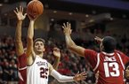Texas Tech's Davide Moretti (25) shoots in front of Arkansas' Mason Jones (13) during the first half of an NCAA college basketball game Saturday, Jan. 26, 2019, in Lubbock, Texas. (AP Photo/Brad Tollefson)
