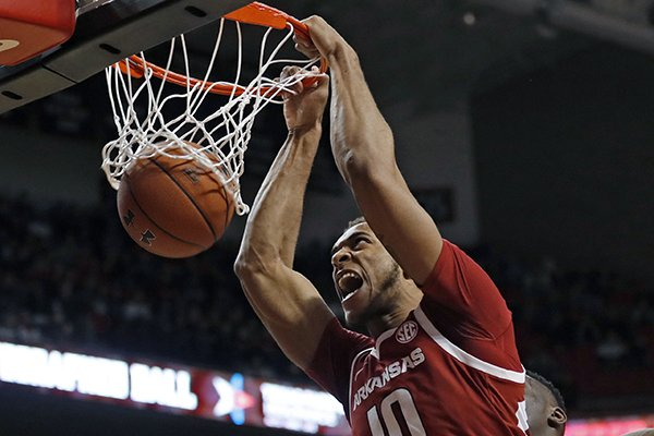 Arkansas' Daniel Gafford (10) dunks during the second half of the team's NCAA college basketball game against Texas Tech, Saturday, Jan. 26, 2019, in Lubbock, Texas. (AP Photo/Brad Tollefson)