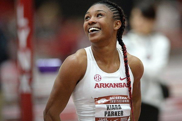 Arkansas' Kiara Parker smiles Saturday, Jan. 26, 2019, as she sees her time in the finals of the 60 meters during the Razorback Invitational in the Randal Tyson Track Center in Fayetteville.