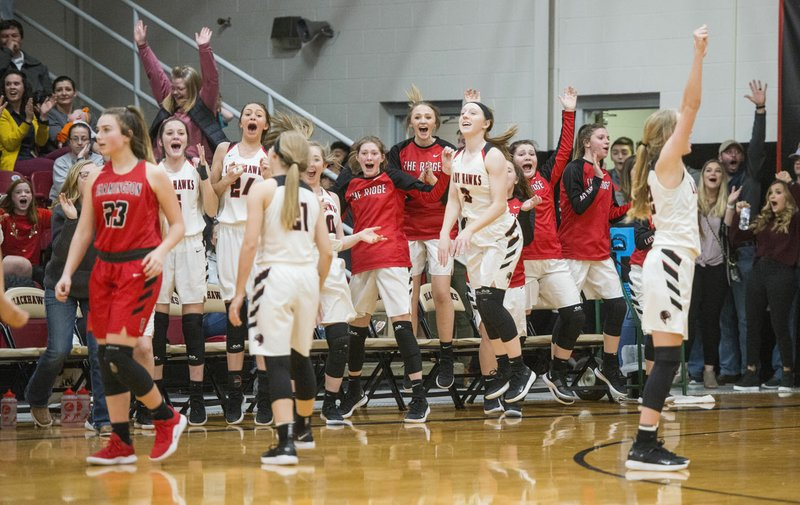 6eeae1bd739 ... Pea Ridge players celebrate after a shot to tie the game at the end of  regulation time vs Farmington Tuesday, Jan. 29, 2019, at Pea Ridge High  School.