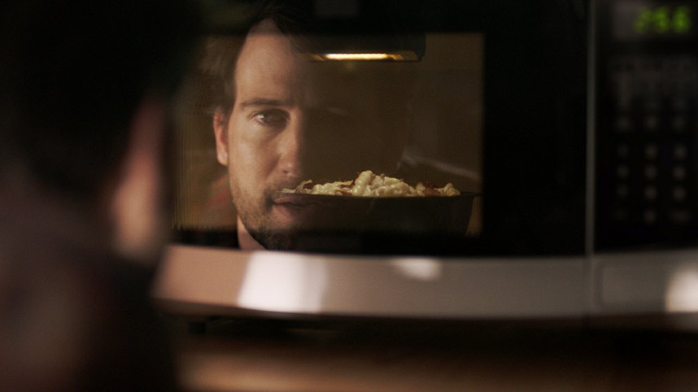 "This undated image provided by Devour shows a scene from Kraft Heinz' frozen-food brand Devour's Super Bowl debut. Devour is trying to make waves during its Super Bowl debut with an ad taking a humorous jab at one man's ""frozen food porn addiction."" (Devour via AP)"