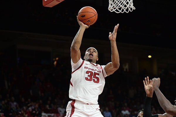Arkansas Reggie Chaney (35) takes a shot in the lane over Georgia guard Tyree Crump Tuesday, Jan. 29, 2019, during the second half of play in Bud Walton Arena.