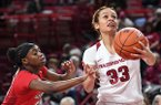 Arkansas' Chelsea Dungee drives to the basket as Georgia's Maya Caldwell defends during a game Thursday Jan. 31, 2019, at Bud Walton Arena in Fayetteville.