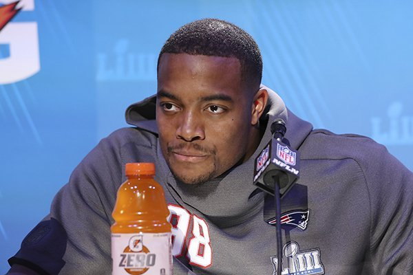 New England Patriots defensive lineman Trey Flowers answers questions during opening night for the NFL Super Bowl 53 football game at State Farm Arena, Monday, Jan. 28, 2019, in Atlanta. (AP Photo/Steve Luciano)