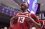 Arkansas guard Mason Jones (13) celebrates with guard Keyshawn Embery-Simpson (11) after an NCAA college basketball game against LSU on Saturday, Feb. 2, 2019, in Baton Rouge, La. Arkansas won 90-89 on Jones' shot. (AP Photo/Bill Feig)
