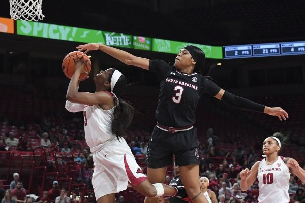 Arkansas' Malica Monk tries to shoot the ball while South Carolina's Destanni Henderson attempts the block Sunday Feb. 3, 2019 at Bud Walton Arena in Fayetteville. The Hogs lost 87-79 and are back at home Sunday against Auburn.