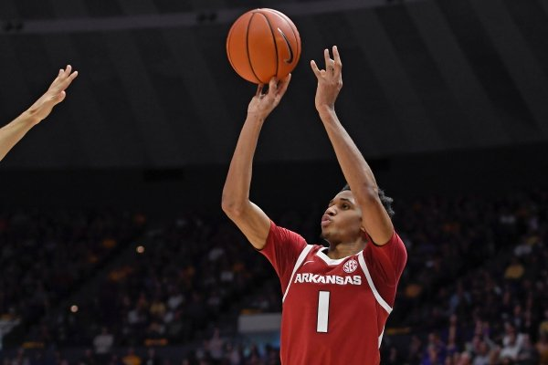 Arkansas guard Isaiah Joe shoots a 3-pointer during the second half of an NCAA college basketball game against LSU on Saturday, Feb. 2, 2019, in Baton Rouge, La. Arkansas won 90-89. (AP Photo/Bill Feig)
