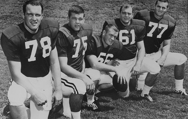 Arkansas' offensive line in 1964 included Jerry Jones (61), who a quarter-century later bought the Dallas Cowboys. Other line members included Glen Ray Hines (78), Jerry Welch (75), Randy Stewart (66) and Ernest Ruple (77).