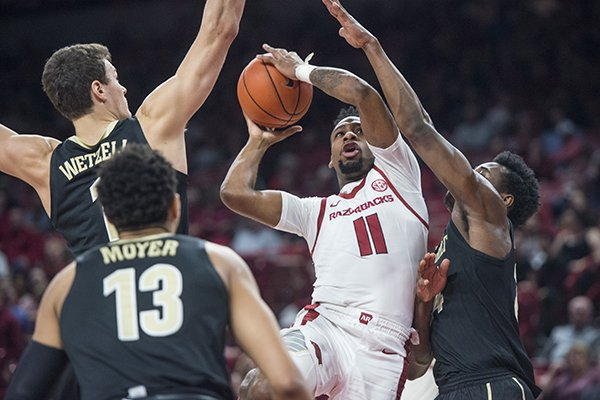 Arkansas guard Keyshawn Embery-Simpson goes up for a shot between three Vanderbilt defenders on Tuesday, Feb. 5, 2019, in Fayetteville.