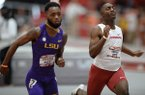 Arkansas' Rashad Boyd (right) finishes alongside LSU's Correion Mosby as he competes in the 60 meters Saturday, Jan. 26, 2019, during the Razorback Invitational in the Randal Tyson Track Center in Fayetteville.