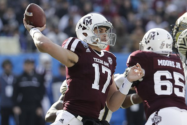 FILE — Texas A&M's Nick Starkel (17) looks to pass against Wake Forest during the first half of the Belk Bowl NCAA college football game in Charlotte, N.C., Friday, Dec. 29, 2017. (AP Photo/Chuck Burton)