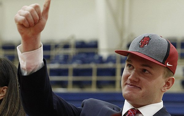 Pulaski Academy tight end Hudson Henry gives the thumbs up after signing a national letter of intent to play for the University of Arkansas during the PA signing day on Wednesday, Feb. 6, 2019, at Pulaski Academy in Little Rock.