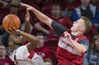 Arkansas guard Jonathan Holmes blocks a shot by guard Keyshawn Embery-Simpson during the Razorbacks' Red-White Game on Friday, Oct. 19, 2018, in Fayetteville.