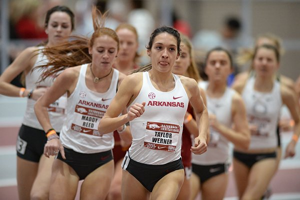 Arkansas' Taylor Werner (center) competes in the 3,000-meter Invitational Saturday, Jan. 26, 2019, during the Razorback Invitational in the Randal Tyson Track Center in Fayetteville.