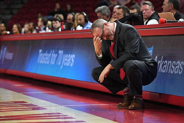 Arkansas coach Mike Neighbors shakes his head during a game against Georgia on Thursday, Jan. 31, 2019, in Fayetteville.