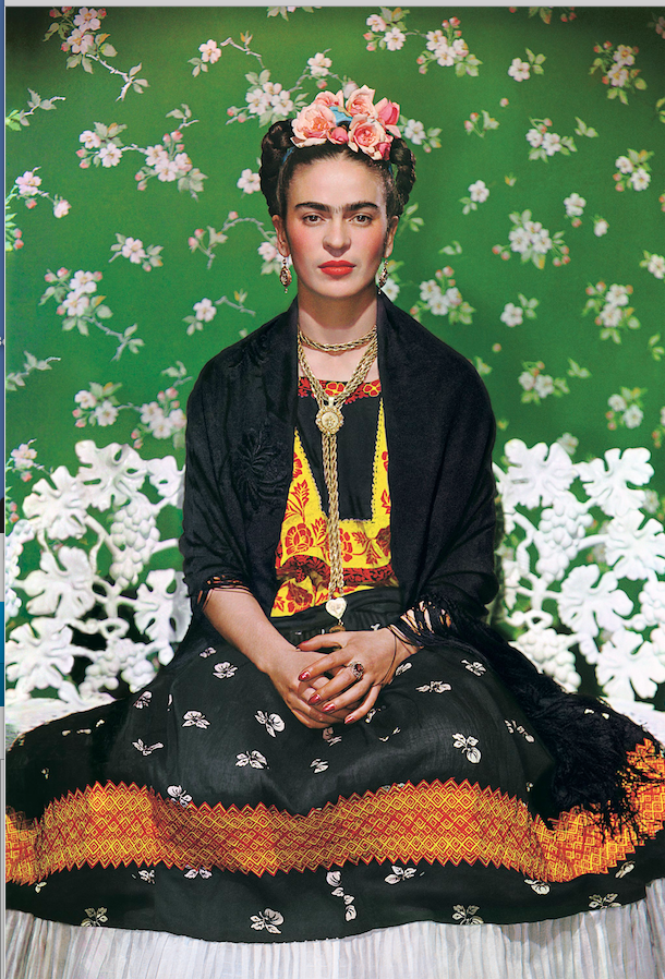 """Frida Kahlo on White Bench, New York (2nd Edition),"" was taken in 1939 by Nickolas Muray. (Courtesy Throckmorton Fine Art, New York)"