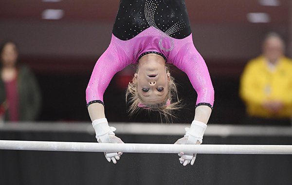 Alabama gymnast Shea Mahoney competes against Arkansas during an NCAA Gymnastics meet, Feb. 8, 2019 in Fayetteville. (AP Photo/Michael Woods)