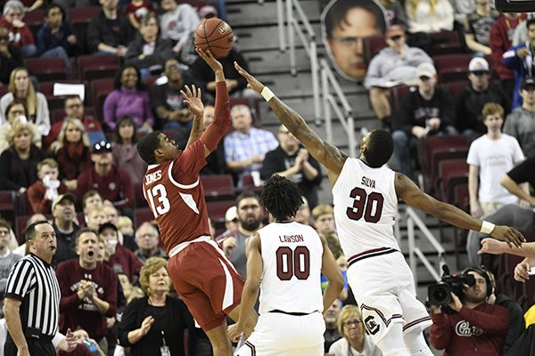 Arkansas guard Mason Jones shoots over South Carolina forward Chris Silva during a game Saturday, Feb. 9, 2019, in Columbia, S.C.
