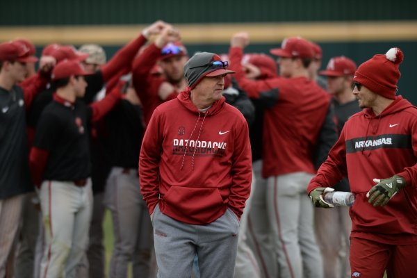 Arkansas coach Dave Van Horn walks back to the dugout after speaking to his players Friday, Jan. 25, 2019, during practice at Baum Stadium in Fayetteville.