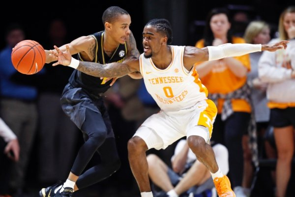 Tennessee guard Jordan Bone (0) attempts to steal the ball from Missouri guard Xavier Pinson (1) during the first half of an NCAA college basketball game Tuesday, Feb. 5, 2019, in Knoxville, Tenn. (AP photo/Wade Payne)
