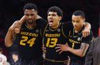 Missouri guard Mark Smith (13) is helped off the court by teammates Kevin Puryear (24), and Xavier Pinson (1) after he hurt his ankle playing against Arkansas during the second half of an NCAA basketball game, Wednesday, Jan. 23, 2019 in Fayetteville, Ark. (AP Photo/Michael Woods)