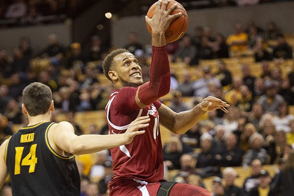 Arkansas's Daniel Gafford, right, shoots past Missouri's Reed Nikko, left, during the first half of an NCAA college basketball game Tuesday, Feb. 12, 2019, in Columbia, Mo. (AP Photo/L.G. Patterson)
