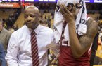 Arkansas head coach Mike Anderson, left, comforts player Gabe Osabuohien, right, after they lost 79-78 to Missouri in an NCAA college basketball game Tuesday, Feb. 12, 2019, in Columbia, Mo. (AP Photo/L.G. Patterson)