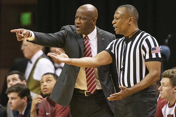 Arkansas head coach Mike Anderson, left, argues a call with a referee during the first half of an NCAA college basketball game against Missouri Tuesday, Feb. 12, 2019, in Columbia, Mo. Missouri won the game 79-78. (AP Photo/L.G. Patterson)