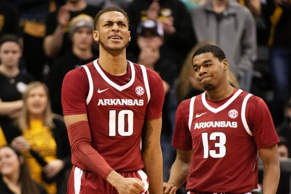 Arkansas's Daniel Gafford, left, reacts after getting called for a foul in front of teammate Mason Jones, right, during the second half of an NCAA college basketball game against Missouri Tuesday, Feb. 12, 2019, in Columbia, Mo. Missouri won the game 79-78. (AP Photo/L.G. Patterson)