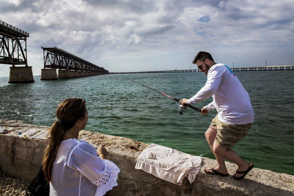 Tyler Burke (right) and Kelsey Turner fish near a rail bridge while visiting Bahia Honda State Park on Bahia Honda Key, Fla.