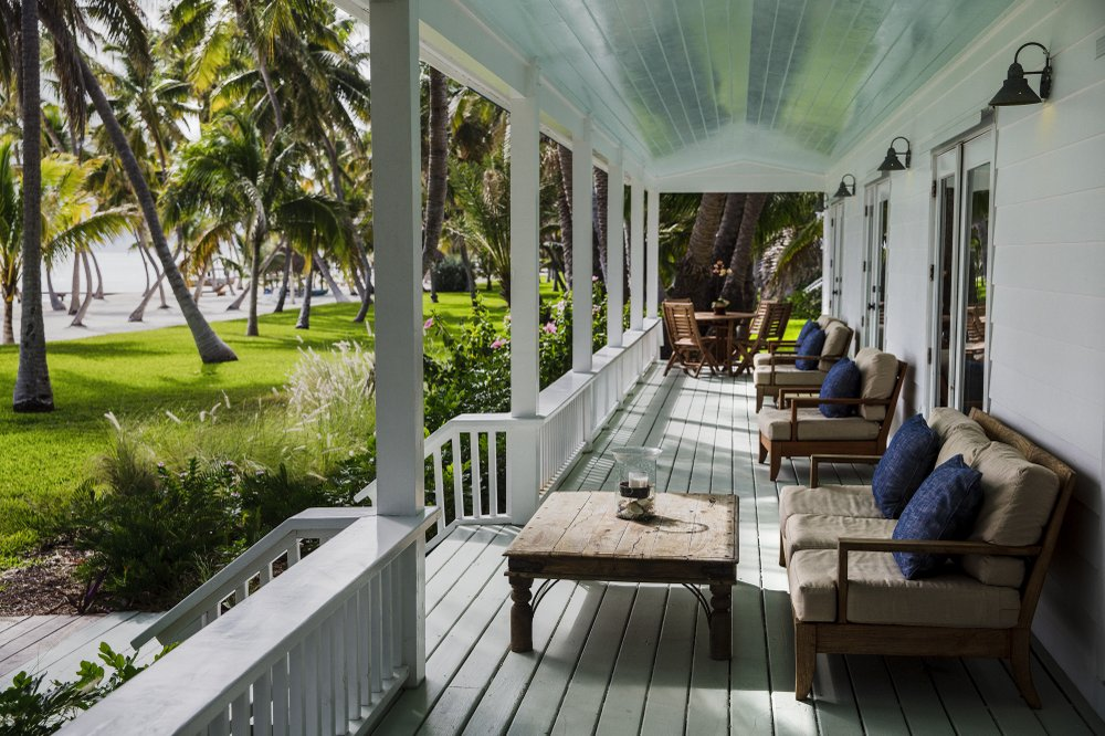 The porch of a villa at Moorings Village in Islamorada, Fla., offers relaxation and beautiful views.