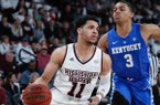 Mississippi State guard Quinndary Weatherspoon (11) tries to drive against the defense of Kentucky guard Keldon Johnson (3) in the first half of an NCAA basketball game against Mississippi State in Starkville, Miss., Saturday, Feb. 9, 2019. Kentucky won 71-67. (AP Photo/Rogelio V. Solis)