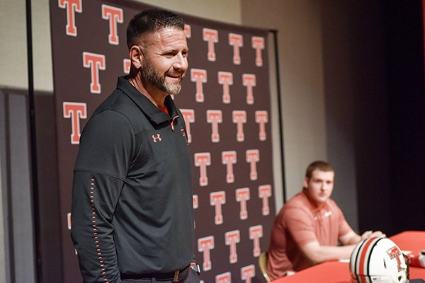 Head coach Kurt Traylor speaks as offensive lineman Beaux Limmer sits at his signing event at Robert E. Lee High School in Tyler, Texas, on Wednesday, Dec. 19, 2018. Limmer signed to play football at the University of Arkansas. (Chelsea Purgahn/Tyler Morning Telegraph)