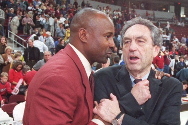 Sidney Moncrief (left) and Eddie Sutton embrace following a game between UALR and Oklahoma State on Tuesday, Nov. 23, 1999, in North Little Rock.