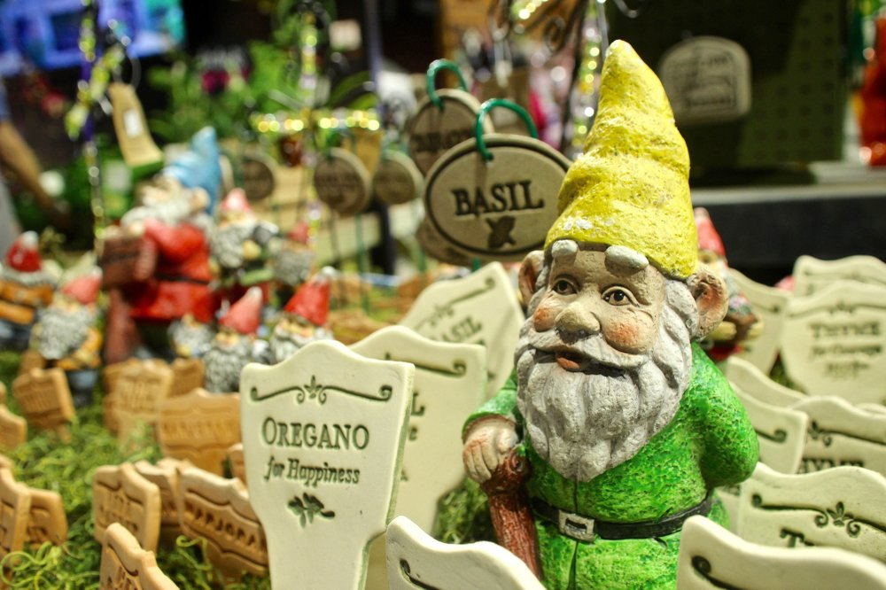 Garden gnome and flower markers in a vendor's booth March 3 in Barton Coliseum during the 2018 Arkansas Flower and Garden Show on the Arkansas State Fairgrounds. Photo by Celia Storey